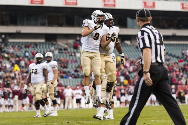 Nov 16, 2013; Philadelphia, PA, USA; UCF Knights wide receiver J.J. Worton (9)  celebrates scoring a touchdown during the fourth quarter against the Temple Owls at Lincoln Financial Field. UCF defeated Temple 39-36. Mandatory Credit: Howard Smith-USA TODAY Sports