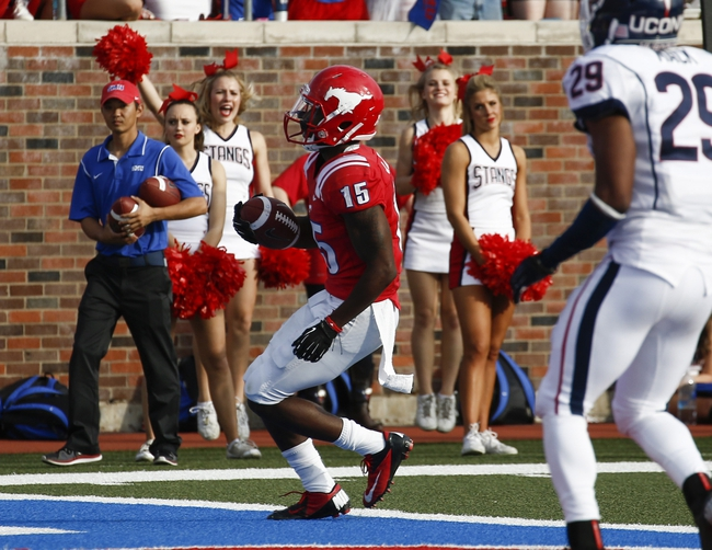Nov 16, 2013; Dallas, TX, USA; Southern Methodist Mustangs wide receiver Jeremy Johnson (15) scores a touchdown after a catch against the Connecticut Huskies during the first half on an NCAA football game at Gerald J. Ford Stadium. Mandatory Credit: Jim Cowsert-USA TODAY Sports