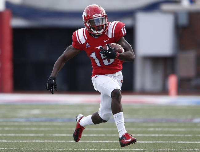 Nov 16, 2013; Dallas, TX, USA; Southern Methodist Mustangs wide receiver Jeremy Johnson (15) runs after a catch against the Connecticut Huskies during the first half on an NCAA football game at Gerald J. Ford Stadium. Mandatory Credit: Jim Cowsert-USA TODAY Sports