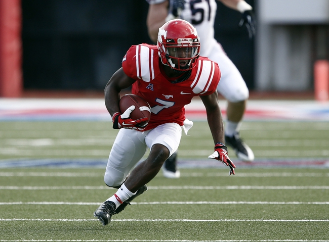 Nov 16, 2013; Dallas, TX, USA; Southern Methodist Mustangs wide receiver Der'rikk Thompson (7) runs after a catch against the Connecticut Huskies during the first half on an NCAA football game at Gerald J. Ford Stadium. Mandatory Credit: Jim Cowsert-USA TODAY Sports