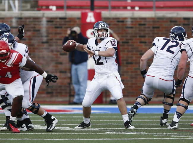 Nov 16, 2013; Dallas, TX, USA; Connecticut Huskies quarterback Casey Cochran (12) prepares to pass against the Southern Methodist Mustangs during the first half on an NCAA football game at Gerald J. Ford Stadium. Mandatory Credit: Jim Cowsert-USA TODAY Sports