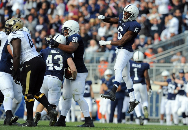 Nov 16, 2013; University Park, PA, USA; Penn State Nittany Lions safety Malik Golden (6) celebrates a fumble recovery by linebacker Mike Hull (43) against the Purdue Boilermakers during the fourth quarter at Beaver Stadium.  Penn State defeated Purdue  45-21.  Mandatory Credit: Rich Barnes-USA TODAY Sports