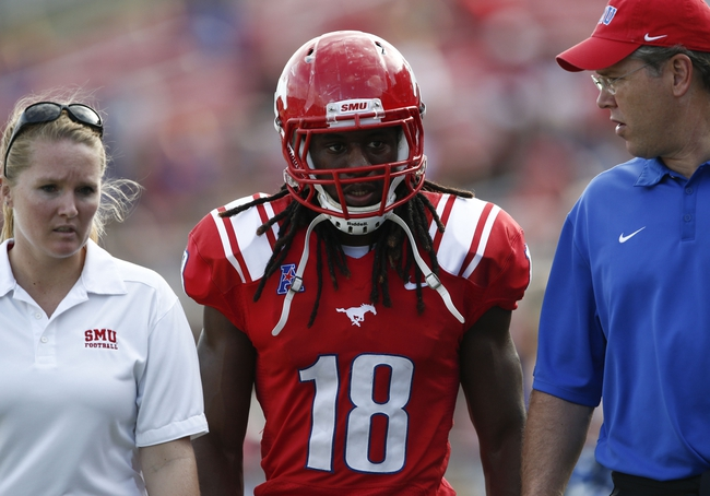 Nov 16, 2013; Dallas, TX, USA; Southern Methodist Mustangs wide receiver Darius Joseph (18) leaves the game with an injury during the first half on an NCAA football game against the Connecticut Huskies at Gerald J. Ford Stadium. Mandatory Credit: Jim Cowsert-USA TODAY Sports