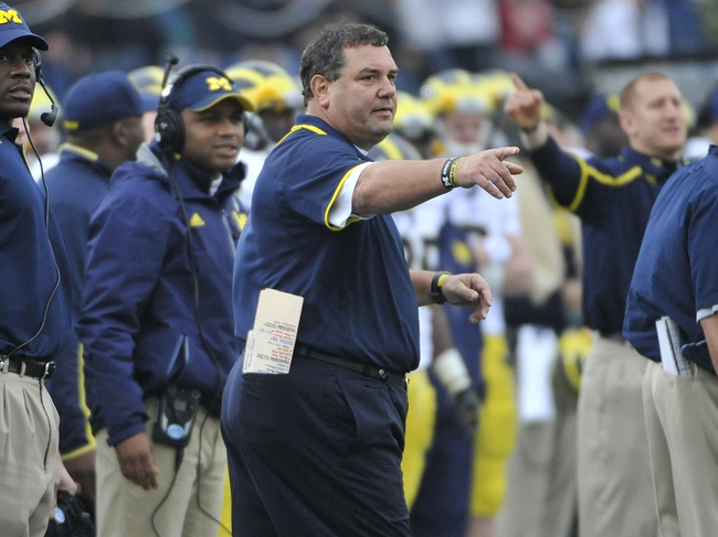 Nov 16, 2013; Evanston, IL, USA;  Michigan Wolverines head coach Brady Hoke coaches from the sidelines against the Northwestern Wildcats during the first half at Ryan Field. Mandatory Credit: David Banks-USA TODAY Sports