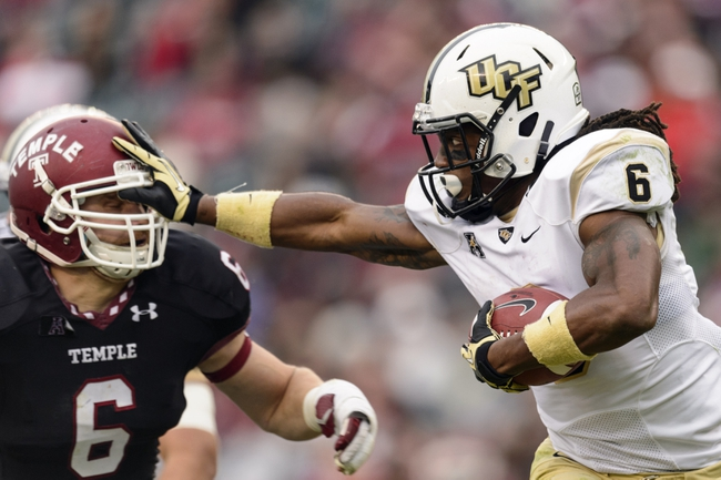 Nov 16, 2013; Philadelphia, PA, USA; UCF Knights wide receiver Rannell Hall (6) stiff arms Temple Owls linebacker Blaze Caponegro (6) during the fourth quarter at Lincoln Financial Field. UCF defeated Temple 39-36. Mandatory Credit: Howard Smith-USA TODAY Sports