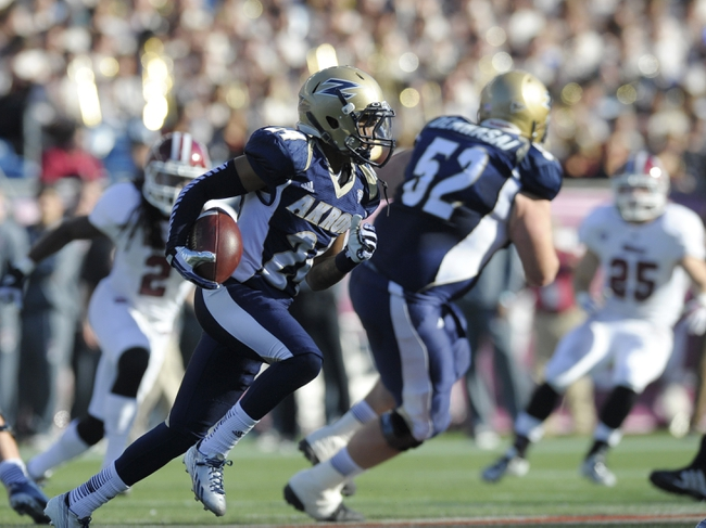 Nov 16, 2013; Foxborough, MA, USA; Akron Zips wide receiver Fransohn Bickley (24) runs with the ball during the first half against the Akron Zips at Gillette Stadium. Mandatory Credit: Bob DeChiara-USA TODAY Sports