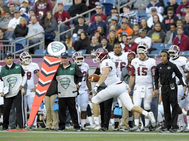 Nov 16, 2013; Foxborough, MA, USA; Massachusetts Minutemen quarterback Mike Wegzyn (11) runs for a gain during the first half against the Akron Zips at Gillette Stadium. Mandatory Credit: Bob DeChiara-USA TODAY Sports