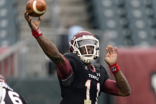 Nov 16, 2013; Philadelphia, PA, USA; Temple Owls quarterback P.J. Walker (11) passes the ball during the third quarter against the UCF Knights at Lincoln Financial Field. UCF defeated Temple 39-36. Mandatory Credit: Howard Smith-USA TODAY Sports