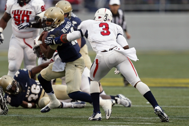 Nov 16, 2013; Annapolis, MD, USA; Navy Midshipmen quarterback Keenan Reynolds (19) runs for a gain past South Alabama Jaguars safety Charles Watson (3) at Navy Marine Corps Memorial Stadium. Mandatory Credit: Mitch Stringer-USA TODAY Sports