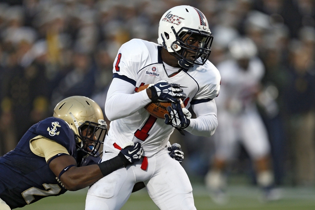 Nov 16, 2013; Annapolis, MD, USA; South Alabama Jaguars wide receiver Shavarez Smith (1) scores a first half touchdown past diving Navy Midshipmen Parrish Gaines (2) at Navy Marine Corps Memorial Stadium. Mandatory Credit: Mitch Stringer-USA TODAY Sports