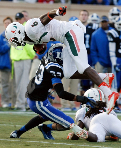 Nov 16, 2013; Durham, NC, USA; Miami Hurricanes wide receiver Herb Waters (6) leaps over Duke Blue Devils cornerback Deondre Singleton (33) at Wallace Wade Stadium. Mandatory Credit: Mark Dolejs-USA TODAY Sports