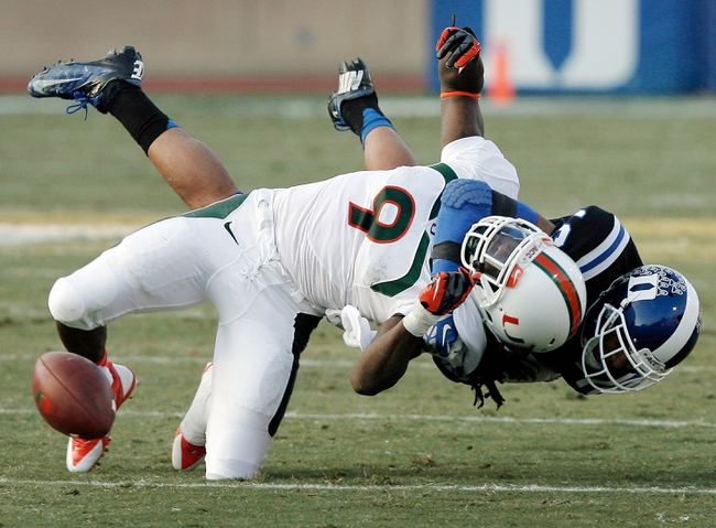 Nov 16, 2013; Durham, NC, USA; Duke Blue Devils safety Jeremy Cash (16) breaks up a pass intended for Miami Hurricanes wide receiver Malcolm Lewis (9) at Wallace Wade Stadium. Mandatory Credit: Mark Dolejs-USA TODAY Sports