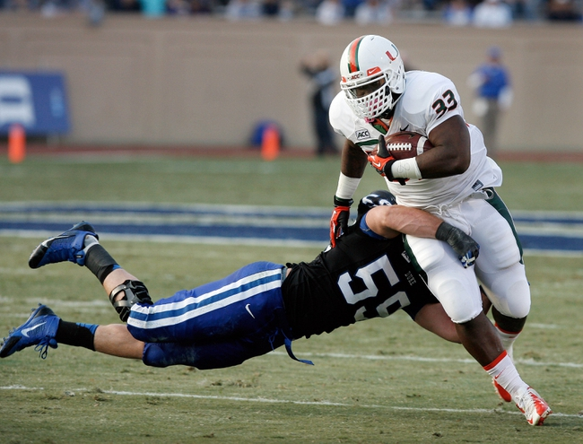 Nov 16, 2013; Durham, NC, USA; Duke Blue Devils linebacker Kelby Brown (59) tackles Miami Hurricanes fullback Maurice Hagens (33) at Wallace Wade Stadium. Mandatory Credit: Mark Dolejs-USA TODAY Sports