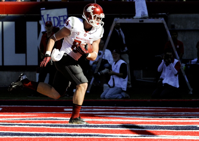 Nov 16, 2013; Tucson, AZ, USA; Washington State Cougars wide receiver River Cracraft (84) scores a touchdown during the third quarter against the Arizona Wildcats at Arizona Stadium. The Cougars beat the Wildcats 24-17. Mandatory Credit: Casey Sapio-USA TODAY Sports