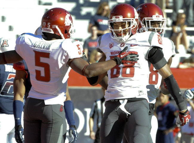 Nov 16, 2013; Tucson, AZ, USA; Washington State Cougars wide receiver Isiah Myers (88) is congratulated by wide receiver Rickey Galvin (5) after scoring a touchdown during the fourth quarter against the Arizona Wildcats at Arizona Stadium. The Cougars beat the Wildcats 24-17. Mandatory Credit: Casey Sapio-USA TODAY Sports
