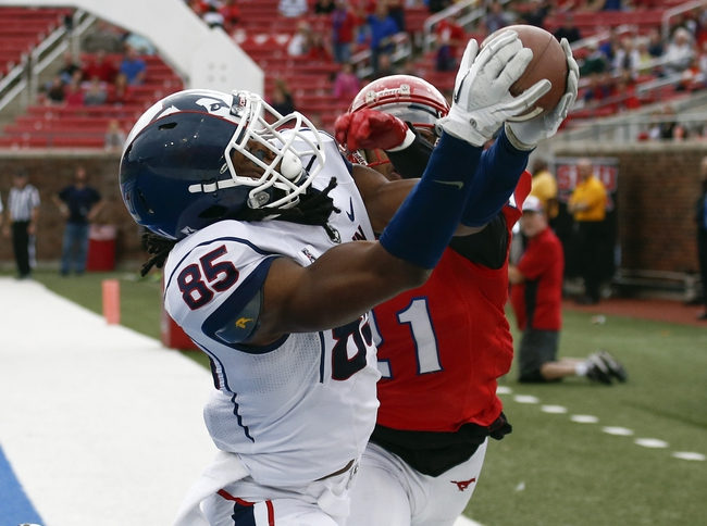 Nov 16, 2013; Dallas, TX, USA; Connecticut Huskies wide receiver Geremy Davis (85) catches a pass against Southern Methodist Mustangs defensive back Kenneth Acker (21) during the second half on an NCAA football game at Gerald J. Ford Stadium. The play was ruled out of bounds. Southern Methodist Mustangs won 38-21. Mandatory Credit: Jim Cowsert-USA TODAY Sports