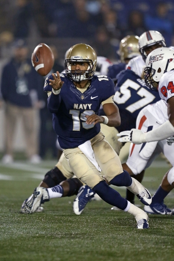 Nov 16, 2013; Annapolis, MD, USA; Navy Midshipmen quarterback Keenan Reynolds (19) makes an option toss against the South Alabama Jaguars at Navy Marine Corps Memorial Stadium. Mandatory Credit: Mitch Stringer-USA TODAY Sports