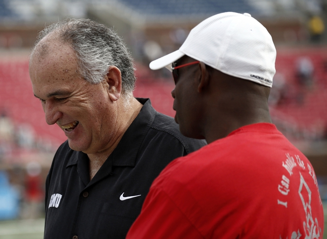 Nov 16, 2013; Dallas, TX, USA; Southern Methodist Mustangs head coach June Jones talks to former NFL football player Deon Sanders (right) before a NCAA football game against the Connecticut Huskies at Gerald J. Ford Stadium. Mandatory Credit: Jim Cowsert-USA TODAY Sports