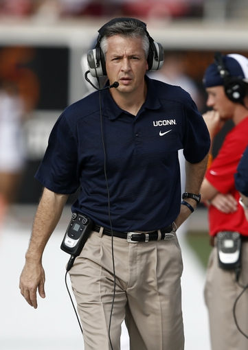 Nov 16, 2013; Dallas, TX, USA; Connecticut Huskies interim head coach T.J. Weist works the sidelines during the first half on an NCAA football game against the Southern Methodist Mustangs at Gerald J. Ford Stadium. Mandatory Credit: Jim Cowsert-USA TODAY Sports