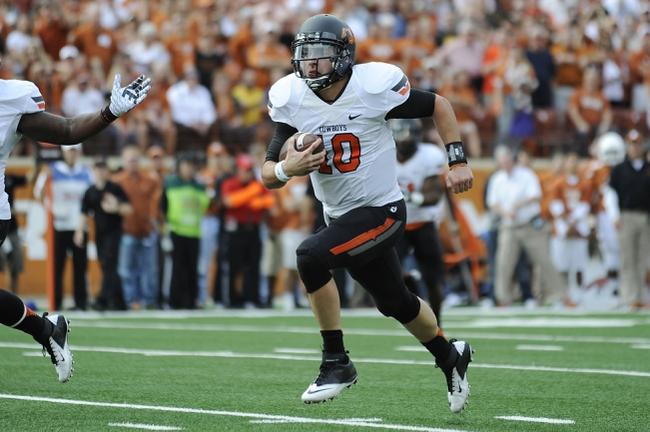Nov 16, 2013; Austin, TX, USA; Oklahoma State Cowboys quarterback Clint Chelf (10) runs with the ball against the Texas Longhorns during the first quarter at Darrell K Royal-Texas Memorial Stadium. Oklahoma State won 38-13. Mandatory Credit: Brendan Maloney-USA TODAY Sports