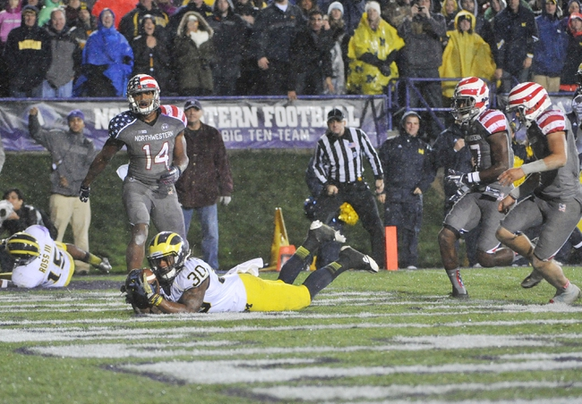 Nov 16, 2013; Evanston, IL, USA; Michigan Wolverines safety Thomas Gordon (30) intercepts a pass to end the game against the Northwestern Wildcats in the third overtime at Ryan Field. The Michigan Wolverines defeated the Northwestern Wildcats 27-19 in triple overtime. Mandatory Credit: David Banks-USA TODAY Sports