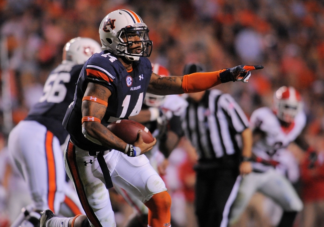 Nov 16, 2013; Auburn, AL, USA; Auburn Tigers quarterback Nick Marshall (14) runs the ball during the second half against the Georgia Bulldogs at Jordan Hare Stadium. The Tigers defeated the Bulldogs 43-38. Mandatory Credit: Shanna Lockwood-USA TODAY Sports