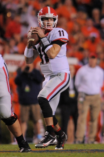 Nov 16, 2013; Auburn, AL, USA; Georgia Bulldogs quarterback Aaron Murray (11) looks to pass during the second half against the Auburn Tigers at Jordan Hare Stadium. The Tigers defeated the Bulldogs 43-38. Mandatory Credit: Shanna Lockwood-USA TODAY Sports