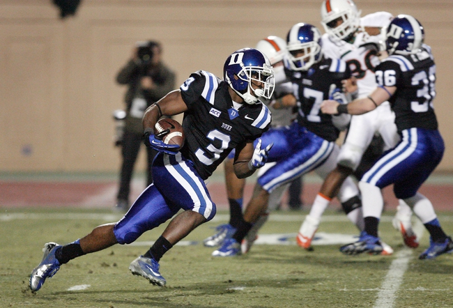 Nov 16, 2013; Durham, NC, USA; Duke Blue Devils wide receiver Jamison Crowder (3) carries the ball on a kickoff return against the Miami Hurricanes at Wallace Wade Stadium. Mandatory Credit: Mark Dolejs-USA TODAY Sports