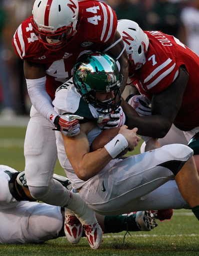 Nov 16, 2013; Lincoln, NE, USA; Nebraska Cornhuskers defenders Randy Gregory (44) and Maliek Collins (7) tackle Michigan State Spartans quarterback Conner Cook (18) in the third quarter at Memorial Stadium. Michigan State won 41-28. Mandatory Credit: Bruce Thorson-USA TODAY Sports