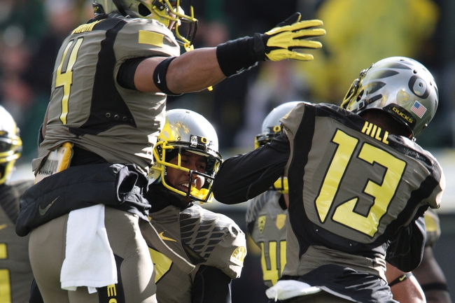 Nov 16, 2013; Eugene, OR, USA; Oregon Ducks celebrate following a interception by Ducks defensive back Troy Hill (13) against the Utah Utes at Autzen Stadium. Mandatory Credit: Scott Olmos-USA TODAY Sports