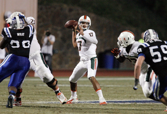 Nov 16, 2013; Durham, NC, USA; Miami Hurricanes quarterback Stephen Morris (17) looks to throw against the Duke Blue Devils defense at Wallace Wade Stadium. Mandatory Credit: Mark Dolejs-USA TODAY Sports