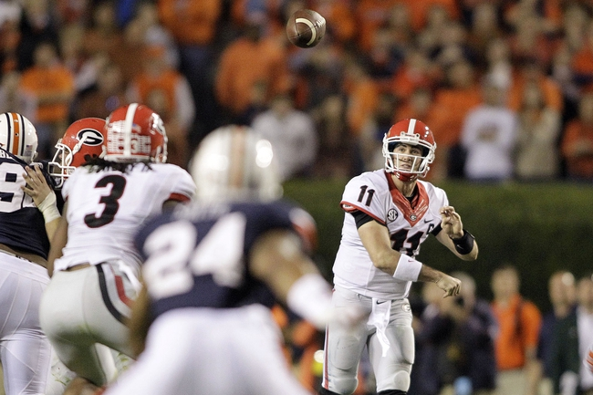 Nov 16, 2013; Auburn, AL, USA; Georgia Bulldogs quarterback Aaron Murray (11) throws the ball to running back Todd Gurley (3) during the fourth quarter against the Auburn Tigers at Jordan Hare Stadium.  The Tigers won 43-38.  Mandatory Credit: John Reed-USA TODAY Sports