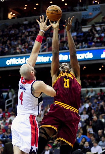 Nov 16, 2013; Washington, DC, USA; Cleveland Cavaliers center Andrew Bynum (21) shoots the ball over Washington Wizards center Marcin Gortat (4) at Verizon Center. Mandatory Credit: Evan Habeeb-USA TODAY Sports