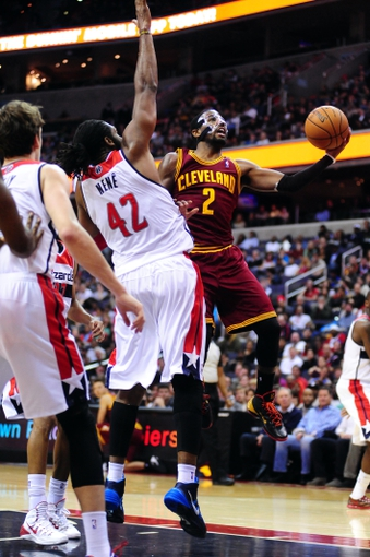 Nov 16, 2013; Washington, DC, USA; Cleveland Cavaliers guard Kyrie Irving (2) lays the ball up over Washington Wizards forward Nene (42) at Verizon Center. Mandatory Credit: Evan Habeeb-USA TODAY Sports