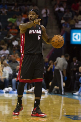 Nov 16, 2013; Charlotte, NC, USA; Miami Heat small forward LeBron James (6) calls out directions during the first half against the Charlotte Bobcats at Time Warner Cable Arena. Mandatory Credit: Jeremy Brevard-USA TODAY Sports