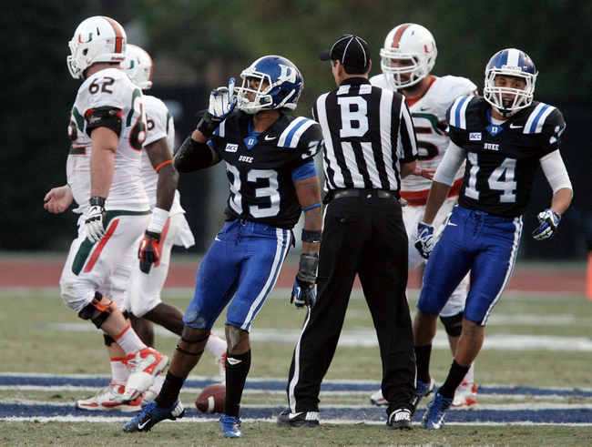 Nov 16, 2013; Durham, NC, USA; Duke Blue Devils cornerback Deondre Singleton (33) reacts after intercepting a Miami Hurricanes pass at Wallace Wade Stadium. Mandatory Credit: Mark Dolejs-USA TODAY Sports