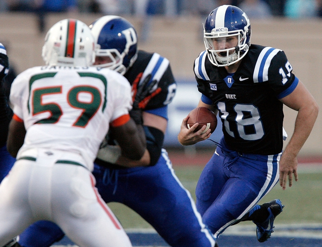 Nov 16, 2013; Durham, NC, USA; Duke Blue Devils quarterback Brandon Connette (18) runs with the ball against the Miami Hurricanes at Wallace Wade Stadium. Mandatory Credit: Mark Dolejs-USA TODAY Sports