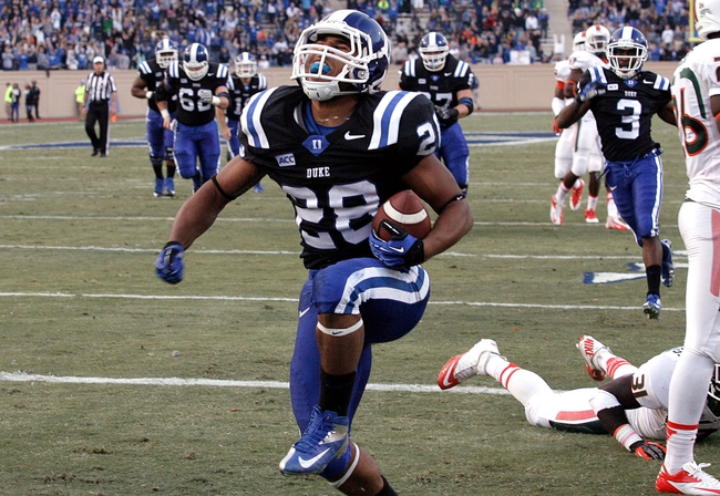 Nov 16, 2013; Durham, NC, USA; Duke Blue Devils running back Shaquille Powell (28) celebrates after scoring a touchdown against the Miami Hurricanes at Wallace Wade Stadium. Mandatory Credit: Mark Dolejs-USA TODAY Sports