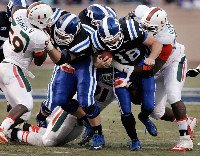 Nov 16, 2013; Durham, NC, USA; Miami Hurricanes defensive lineman Justin Renfrow (78) tackles Duke Blue Devils quarterback Brandon Connette (18) at Wallace Wade Stadium. Mandatory Credit: Mark Dolejs-USA TODAY Sports