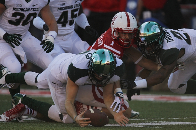 Nov 16, 2013; Lincoln, NE, USA; Michigan State Spartans defender Taybor Pepper (52) recovers the fumble by Nebraska Cornhuskers punt returner Jordan Westerkamp (1) in the first quarter at Memorial Stadium. Michigan State won 41-28. Mandatory Credit: Bruce Thorson-USA TODAY Sports