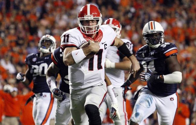 Nov 16, 2013; Auburn, AL, USA; Georgia Bulldogs quarterback Aaron Murray (11) scores a touchdown against the Auburn Tigers during the second half at Jordan Hare Stadium. The Tigers won 43-38. Mandatory Credit: John Reed-USA TODAY Sports