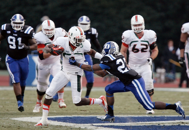 Nov 16, 2013; Durham, NC, USA; Duke Blue Devils cornerback DeVon Edwards (27) tackles Miami Hurricanes wide receiver Allen Hurns (1) at Wallace Wade Stadium. Mandatory Credit: Mark Dolejs-USA TODAY Sports