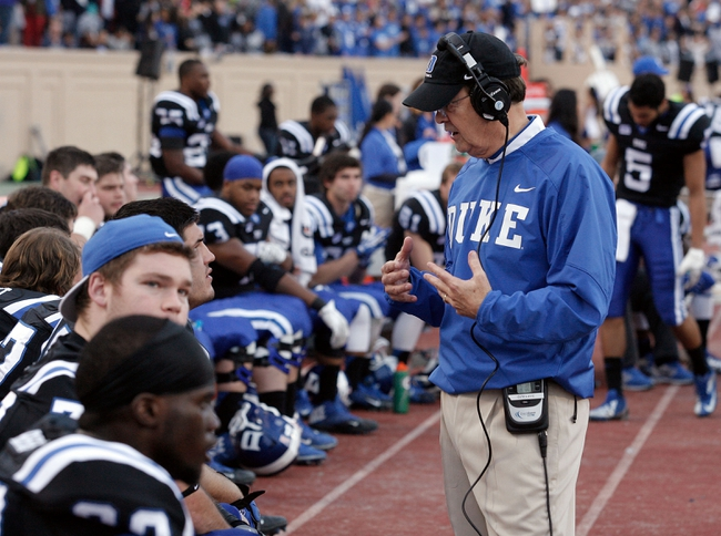 Nov 16, 2013; Durham, NC, USA; Duke Blue Devils head coach David Cutcliffe talks to his players on the sidelines of their game against the Miami Hurricanes at Wallace Wade Stadium. Mandatory Credit: Mark Dolejs-USA TODAY Sports