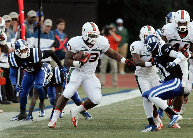 Nov 16, 2013; Durham, NC, USA; Duke Blue Devils cornerback Ross Cockrell (6) and cornerback Breon Borders (31) defend as Miami Hurricanes fullback Maurice Hagens (33) carries the ball at Wallace Wade Stadium. Mandatory Credit: Mark Dolejs-USA TODAY Sports