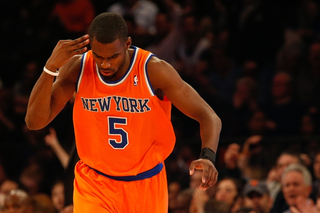 Nov 16, 2013; New York, NY, USA;  New York Knicks shooting guard Tim Hardaway Jr. (5) gestures after scoring a three point basket during the first quarter against the Atlanta Hawks at Madison Square Garden. Mandatory Credit: Anthony Gruppuso-USA TODAY Sports