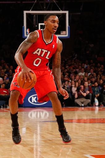 Nov 16, 2013; New York, NY, USA; Atlanta Hawks point guard Jeff Teague (0) controls the ball during the second quarter against the New York Knicks at Madison Square Garden. Mandatory Credit: Anthony Gruppuso-USA TODAY Sports