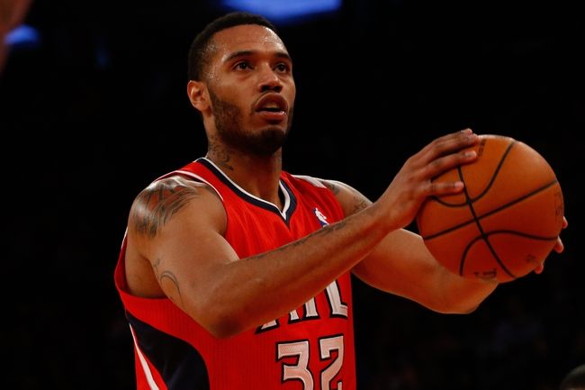 Nov 16, 2013; New York, NY, USA; Atlanta Hawks power forward Mike Scott (32) shoots a free throw during the second quarter against the New York Knicks at Madison Square Garden. Mandatory Credit: Anthony Gruppuso-USA TODAY Sports