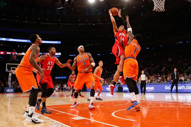 Nov 16, 2013; New York, NY, USA; Atlanta Hawks power forward Gustavo Ayon (14) drives to the basket over New York Knicks power forward Amar'e Stoudemire (1) during the second quarter at Madison Square Garden. Mandatory Credit: Anthony Gruppuso-USA TODAY Sports