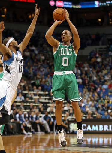 Nov 16, 2013; Minneapolis, MN, USA; Boston Celtics point guard Avery Bradley (0) goes up for a shot in the first half against the Minnesota Timberwolves at Target Center. Mandatory Credit: Jesse Johnson-USA TODAY Sports