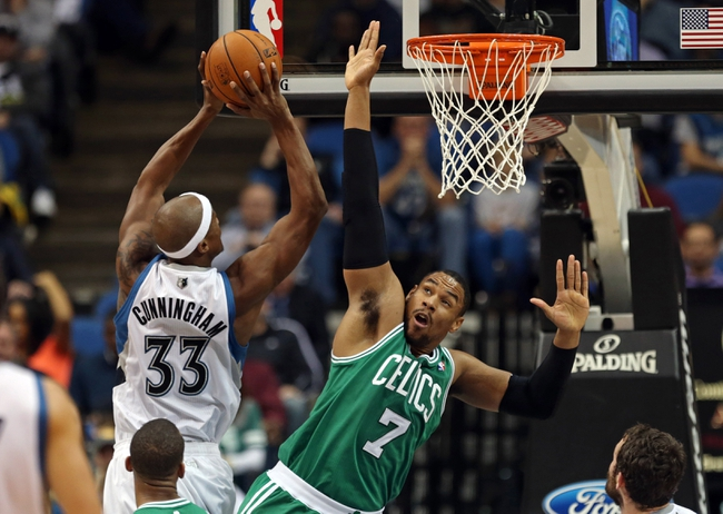Nov 16, 2013; Minneapolis, MN, USA; Minnesota Timberwolves power forward Dante Cunningham (33) goes up for a shot over Boston Celtics power forward Jared Sullinger (7) in the first half at Target Center. Mandatory Credit: Jesse Johnson-USA TODAY Sports